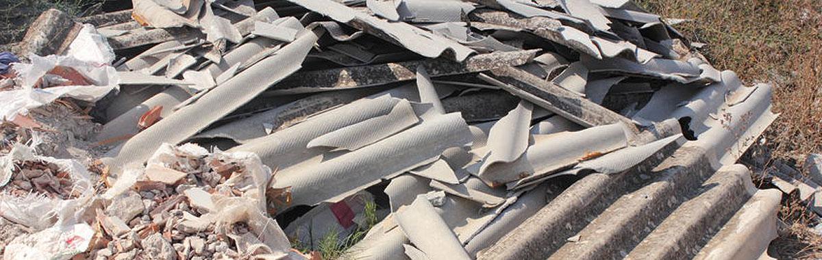 31180816 – asbestos waste dumped on open land